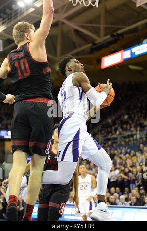 Seattle, WA, USA. 13th Jan, 2018. UW freshman guard Jaylen Nowell (5) goes up for a shot against Stanford defender - Stock Photo