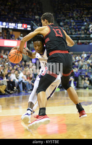 Seattle, WA, USA. 13th Jan, 2018. Stanford's Oscar da Silva (13) defends against UW guard Nahziah Carter (11) during - Stock Photo