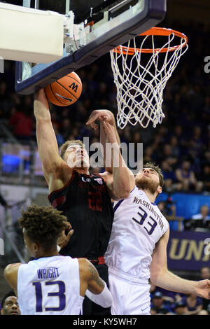 Seattle, WA, USA. 13th Jan, 2018. Stanford's Reid Travis (22) is fouled by UW center Sam Timmins (33) during a PAC12 - Stock Photo