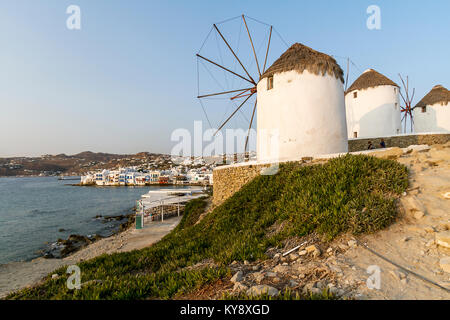 Famous Venetian Windmills of Mykonos at sunset, Mykonos, Greece - Stock Photo