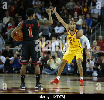 Los Angeles, CA, USA. 14th Jan, 2018. Utah Utes guard Justin Bibbins (1) and USC Trojans guard Jordan McLaughlin - Stock Photo
