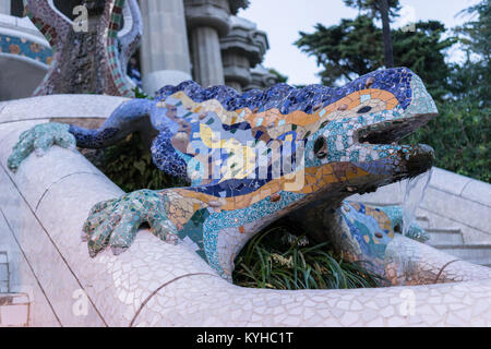 Mosaic and animal sculptural fountain details in Park Gruell in Barcelona, Spain. Ornate architecture, view from - Stock Photo