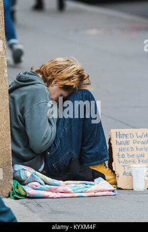 NEW YORK, NY, USA - DECEMBER 2017- Homeless woman on the streets of Manhattan - Stock Photo