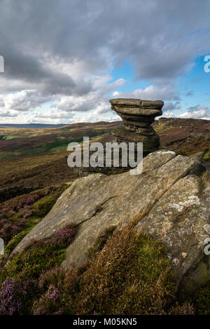 The Salt Cellar on Derwent Edge in the Peak District national park. A gritstone rock formation surrounded by Heather. - Stock Photo