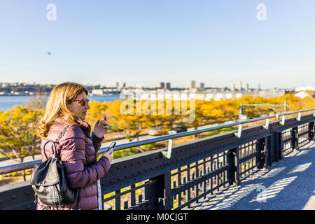 New York City, USA - October 27, 2017: View of Hudson River from highline, high line, urban in NYC with people tourists - Stock Photo