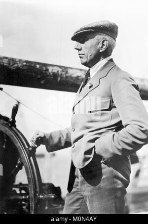 Roald Amundsen. The Norwegian polar explorer Roald Engelbregt Gravning Amundsen (1872-1928) at the wheel of a boat - Stock Photo