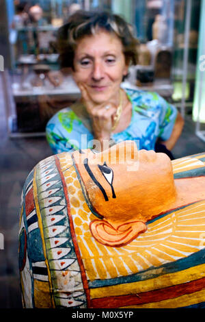 Visitor looking at the sarcophagus of Menrekhmut, The Egyptian Museum / Museo Egizio, Turin, Piedmont, Italy - Stock Photo