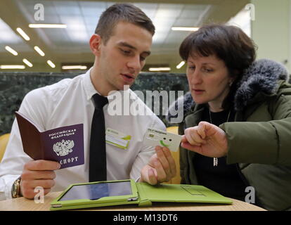 St Petersburg, Russia. 26th Jan, 2018. ST PETERSBURG, RUSSIA - JANUARY 26, 2018: A woman hands over her passport - Stock Photo