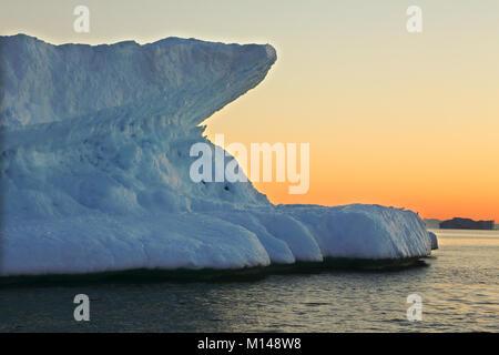 Icebergs from the icefjord, Ilulissat, Disko Bay, Greenland, Polar Regions at sunset - Stock Photo