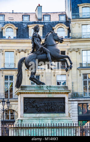 Paris, France - December 10, 2017: Statue of King Louis XIV in Victory Square (Place de Victoires) comissioned by - Stock Photo