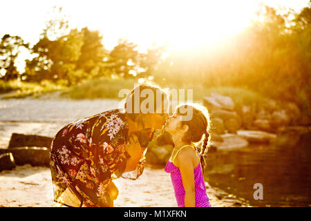 Mother and daughter on beach in Friseboda, Sweden - Stock Photo