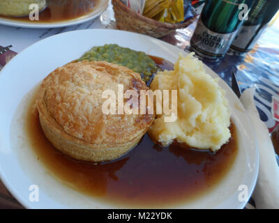 Traditional English Lunch Beef Pie And Potato Chips In A