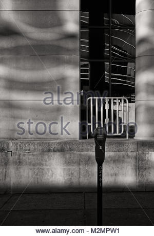 Reflected morning light from the windows across the street. - Stock Photo