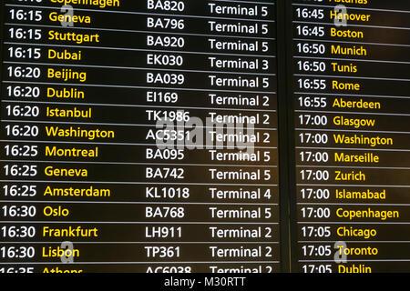 England, London, Heathrow Airport, Flight Departure Board - Stock Photo