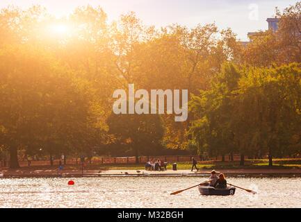 London, UK - November 29, 2014  : People enjoying riding the boat in Hyde park in London. Hyde Park in London is - Stock Photo