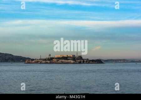 View of Alcatraz Island from Aquatic Park at sunset, San Francisco, California - Stock Photo