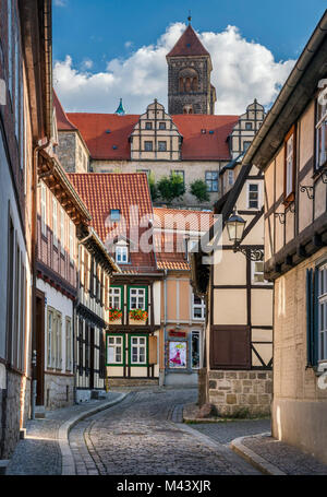 Half-timbered houses near Schlossberg (Castle Hill), tower of St Servatius Church (Stiftskirche) on top, in Quedlinburg, - Stock Photo