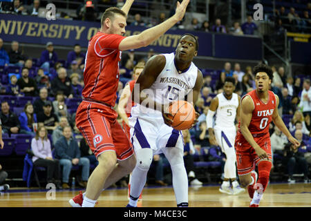 Seattle, WA, USA. 15th Feb, 2018. Utah's David Collette (13) defends against UW center Noah Dickerson (15) during - Stock Photo