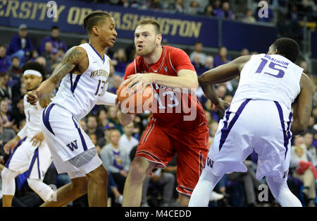 Seattle, WA, USA. 15th Feb, 2018. UW forward Hameir Wright (13) defends against Utah forward David Collette (13) - Stock Photo