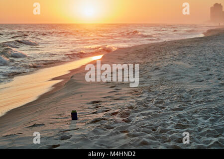 Abandoned soda can on the beach at sunset, Gulf State Park, Alabama - Stock Photo