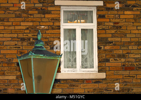 Old fashioned street light outside of a house - Stock Photo