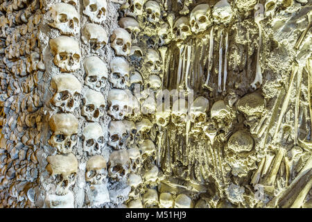 Close-up view of skulls on the wall in the Chapel of Bones in Royal Church of St. Francis, Evora, Alentejo, Portugal - Stock Photo