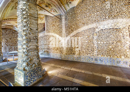 Close-up of a bone-laid pillar and wall, Chapel of Bones in Royal Church of St. Francis, Evora, Alentejo, Portugal - Stock Photo