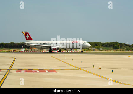 BARCELONA, SPAIN - MAY 30, 2012: A Swiss Airbus 321 starting take off run on from runway 25L in El Prat Barcelona - Stock Photo