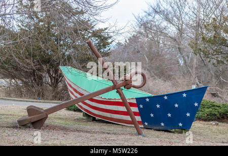 boat painted red white and blue with a large anchor - Stock Photo