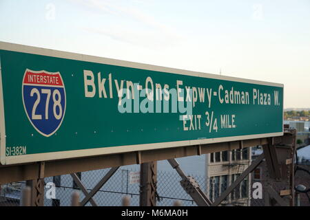 New York City, NY - June 7, 2016: Traffic road sign on the Brooklyn Bridge for the BQE expressway exiting Manhattan - Stock Photo