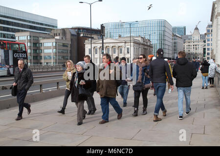 London,UK,5th March 2018,People walking on London Bridge and enjoy the weather as it gets warmer and feels more - Stock Photo