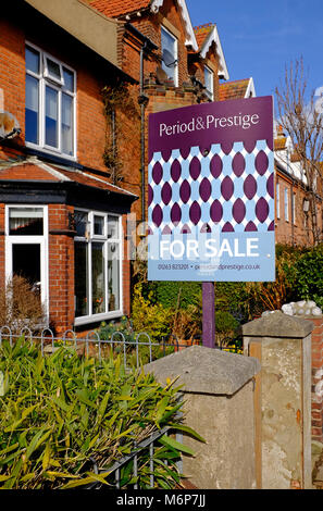 Front garden of victorian terraced house features a for Large victorian homes for sale