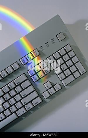 1997 HISTORICAL WOMAN'S HAND PRESSING KEY ON PERSONAL COMPUTER MECHANICAL KEYBOARD (©APPLE CORP 1996) - Stock Photo