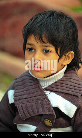 The age of innocence - a beautiful Indian boy poses for the camera. Portrait of young child with large eyes, wearing - Stock Photo