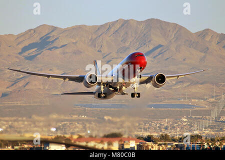 Norwegian Air Plane taking off from the Las Vegas McCarran International Airport withe the Sierra Nevada in the - Stock Photo
