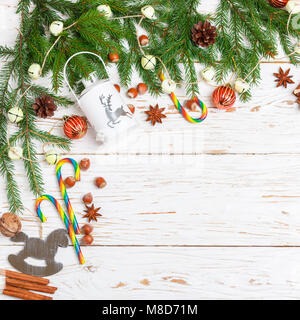 New year background. Fir branches, red balls, flashlight, Christmas decorations, pine cones, candy cane, nuts, cinnamon - Stock Photo