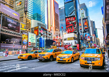 NEW YORK CITY, USA - DECEMBER 01, 2013: Times Square,is a busy tourist intersection of neon art and commerce and - Stock Photo