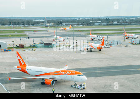 London Gatwick, March 15th, 2018: Airbus A320 airplanes belonging to low cost airliner, easyJet, on tarmac at London - Stock Photo