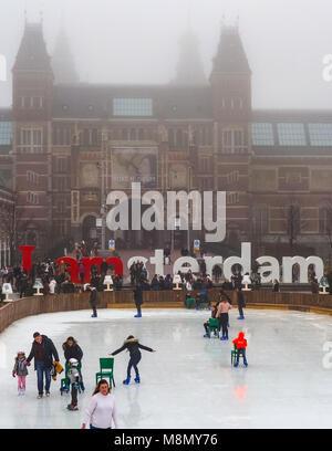 Dec 20, 2017 - People enjoying Ice skating in the gardens of the Rijksmuseum, Amsterdam, Netherlands - Stock Photo