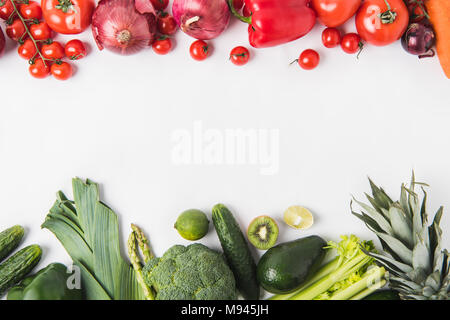 Border of green and red vegetables and fruits isolated on white background - Stock Photo