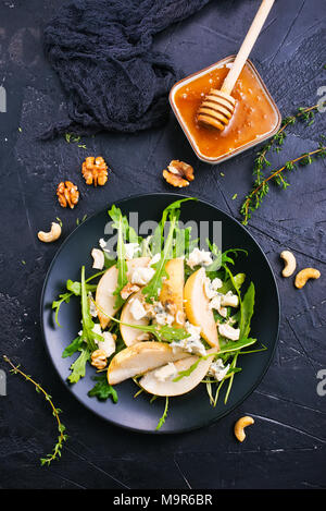 salad with fresh pear spinach nuts, diet food,stock photo - Stock Photo