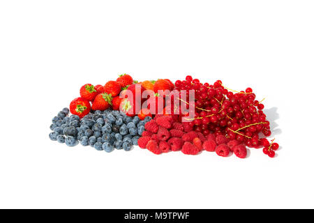 Berry fruits like strawberries, blueberries, red currants and raspberries in a bunch. - Stock Photo
