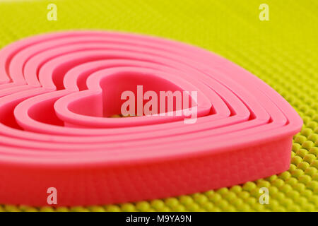 Pink plastic heart on  non skid mat - Stock Photo