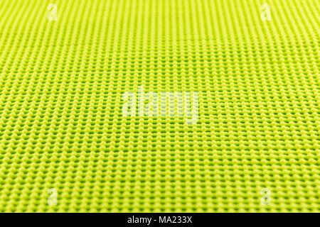 detail of yellow textured non skid mat - Stock Photo