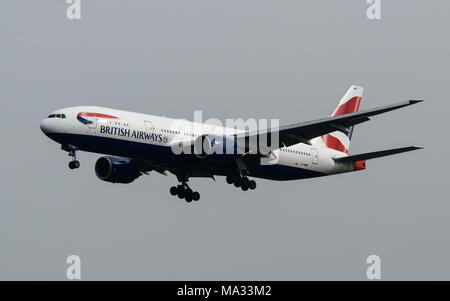 British Airways Boeing 777 landing at London Heathrow Airport - Stock Photo
