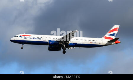 British Airways Airbus A320 landing at London Heathrow Airport - Stock Photo