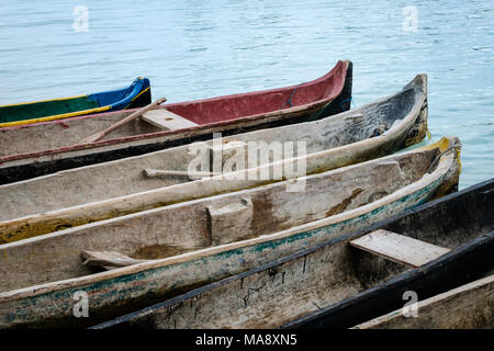Traditional Wooden Canoe Boats At Waterside Paddle Boat