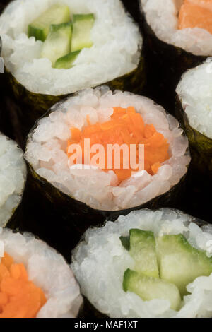 Traditional Japanese sushi maki with carrot and cucumber close up - Stock Photo