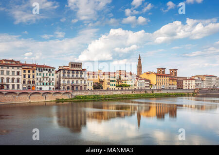 View of Ponte Vecchio with reflections in Arno River, Florence, Italy - Stock Photo
