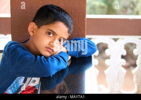 Little boy looking at camera with serious looks at Palande, Kokan - Stock Photo